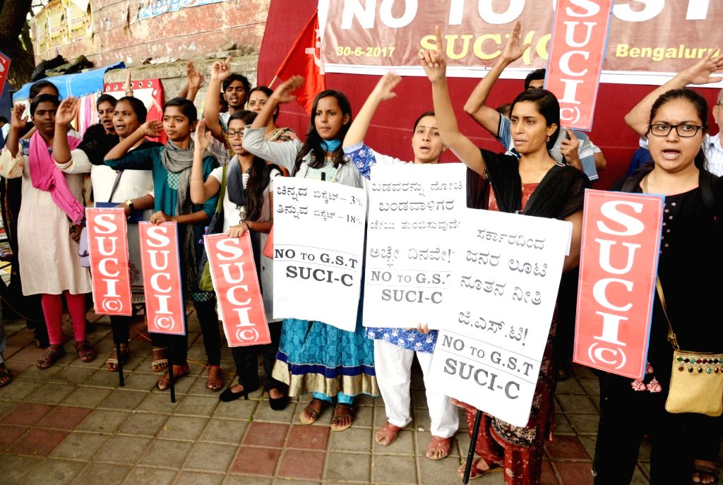 SUCI activists stage a demonstration against GST in Bengaluru on June 30, 2017.