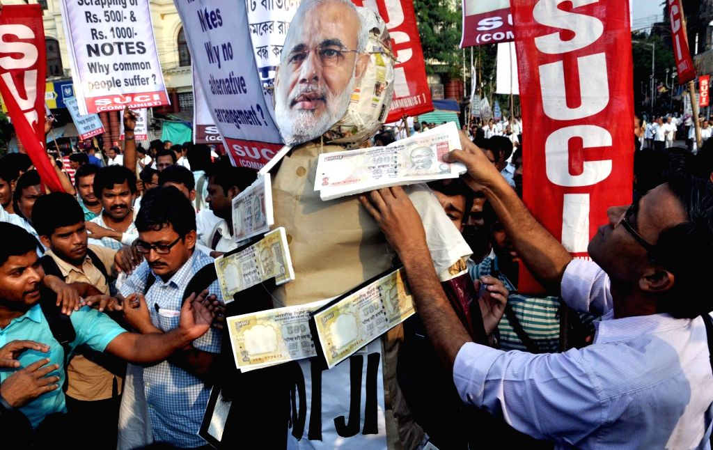 SUCI activists take out a protest rally against demonetisation of Rs 1000 and 500 notes in Kolkata on Nov. 14, 2016.