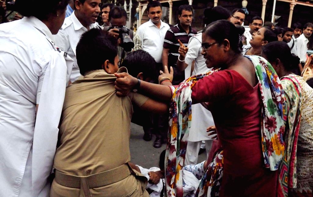 SUCI(C) activists stage a demonstration against the murder of a 21-year old Delhi woman in full public view; in Kolkata on Sept 20, 2016.