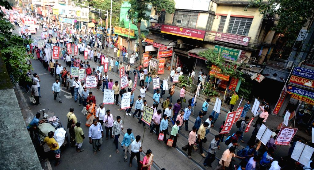 SUCI (C) leaders participate in a protest rally against West Bengal Government over various demand in Kolkata on Nov 13, 2019.