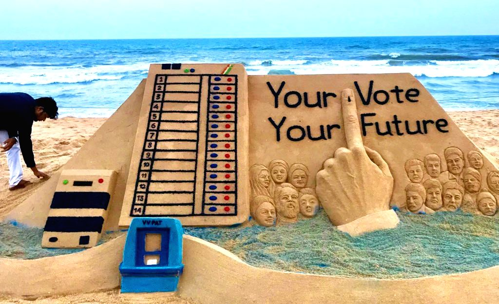 Sudarsan Pattnaik with sand art 'Your Vote Your Future