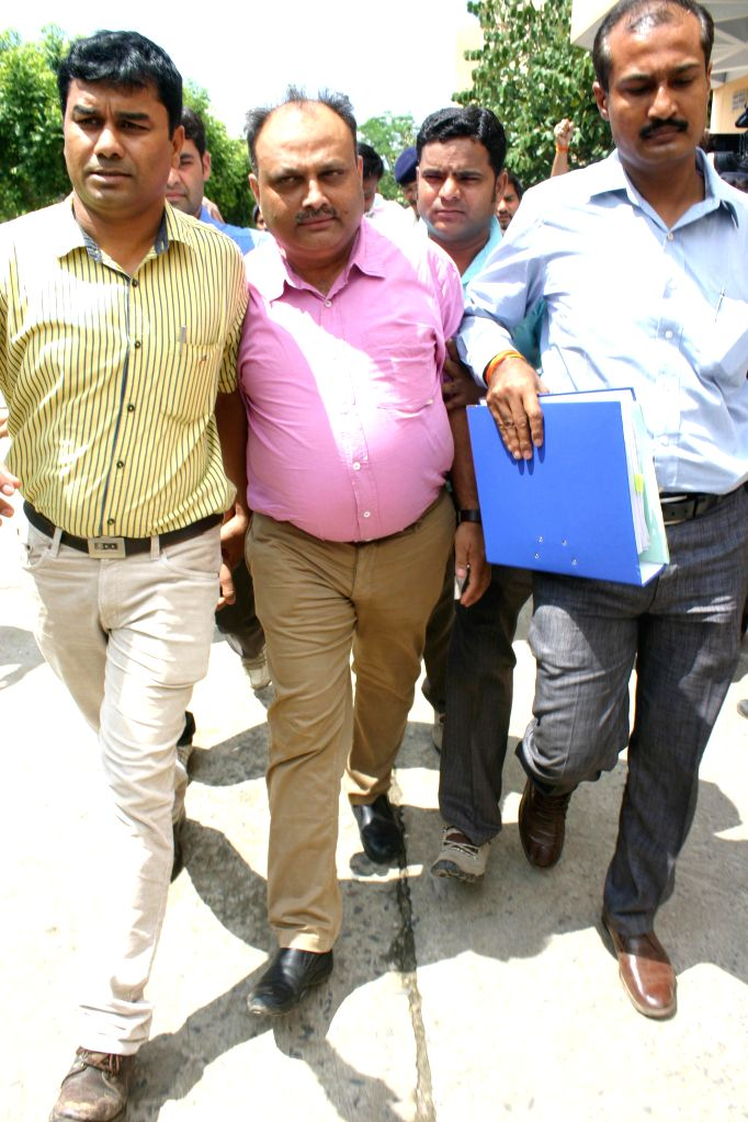 Sudhir Sharma, a mining baron and wanted in Madhya Pradesh Professional Examination Board (MPPEB) scam being taken to jail in Bhopal on July 30, 2014.