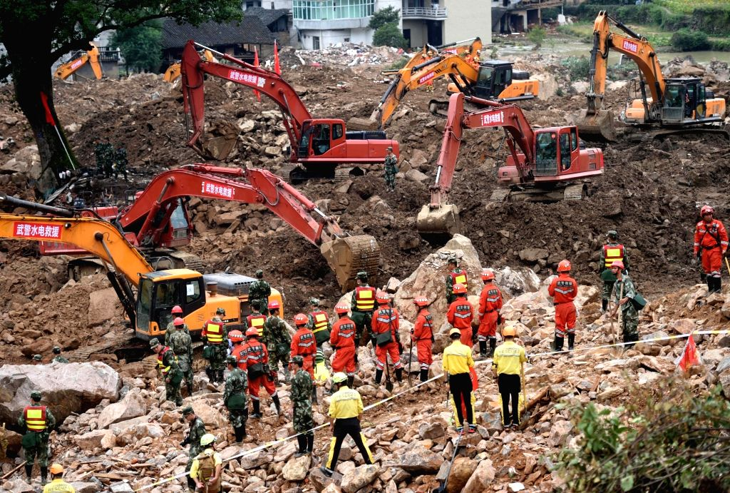 SUICHANG, Oct. 1, 2016 - Rescuers work at the landslide site in Sucun Village, Suichang County of east China's Zhejiang Province, Oct. 1, 2016. Eight people were confirmed dead on Saturday morning ...