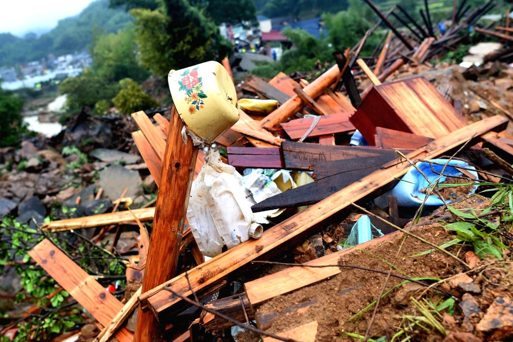 SUICHANG, Sept. 29, 2016 - A food container is seen in the debris at the accident site after a landslide hit Suichang County, east China's Zhejiang Province, Sept. 29, 2016. At least 27 people in ...