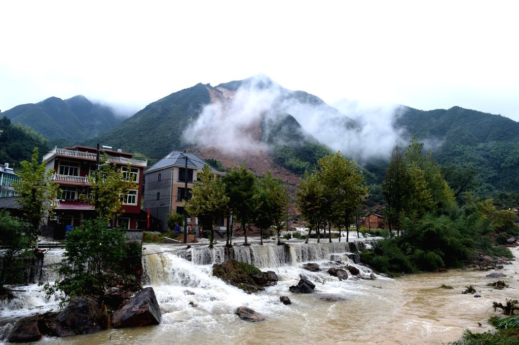 SUICHANG, Sept. 29, 2016 - Photo taken on Sept. 29, 2016 shows the accident site after a landslide hit Sucun Village of Suichang County, east China's Zhejiang Province. Twenty-six residents in the ...