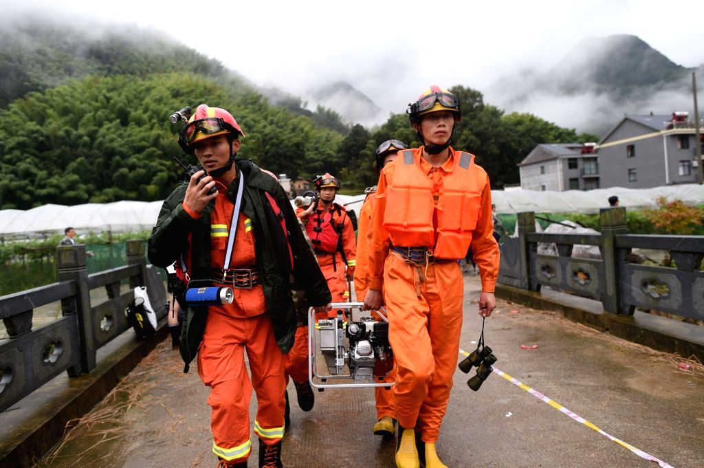 SUICHANG, Sept. 29, 2016 - Rescuers arrive at the accident site after a landslide hit Sucun Village of Suichang County, east China's Zhejiang Province, Sept. 29, 2016. Twenty-six residents in the ...