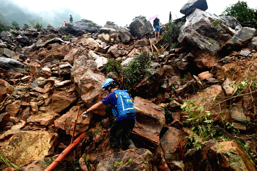 SUICHANG, Sept. 29, 2016 - Zhou Xiaobin, a member of Blue Sky Rescue team, searches for missing people at the accident site after a landslide hit Suichang County, east China's Zhejiang Province, ...