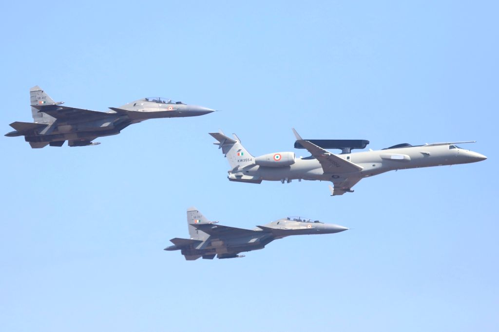 "Sukhoi Su-30MKI combat aircraft and AEW&C aircraft (Center) perform during the inauguration of the ""Aero India 2019"" - air show at Yelahanka Air Force Station, in Bengaluru, ..."
