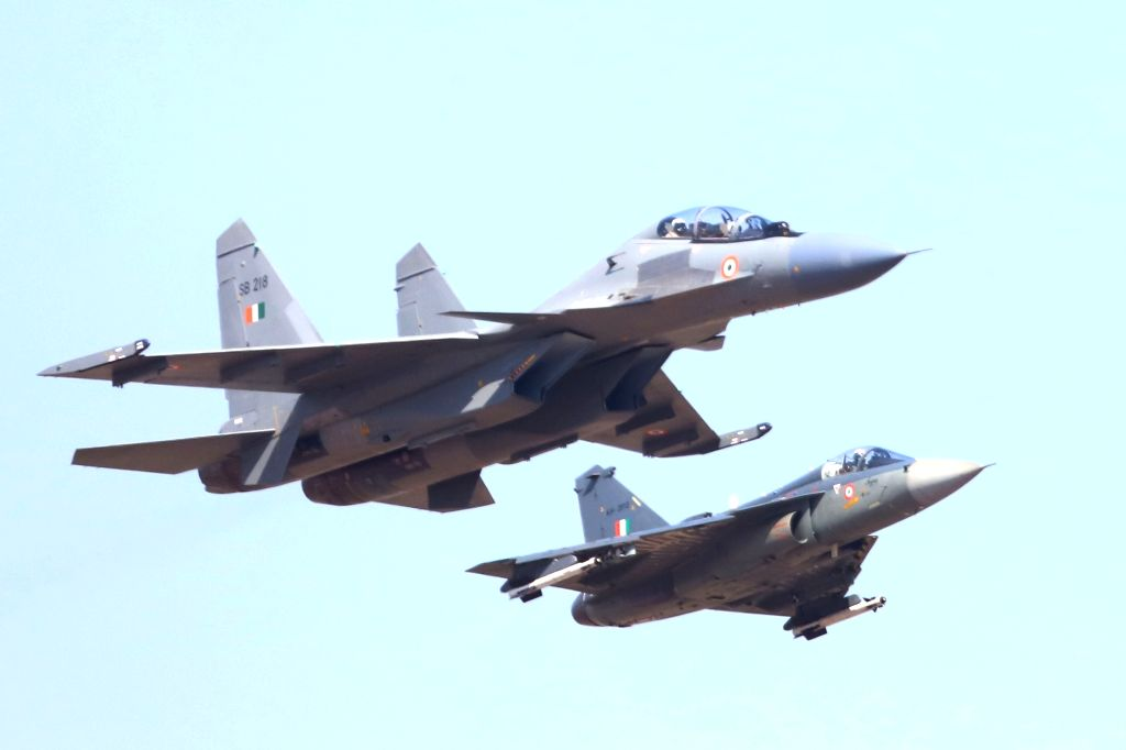 "Sukhoi Su-30MKI combat aircraft and Tejas Light combat aircraft perform during the inauguration of the ""Aero India 2019"" - air show at Yelahanka Air Force Station, in Bengaluru, ..."