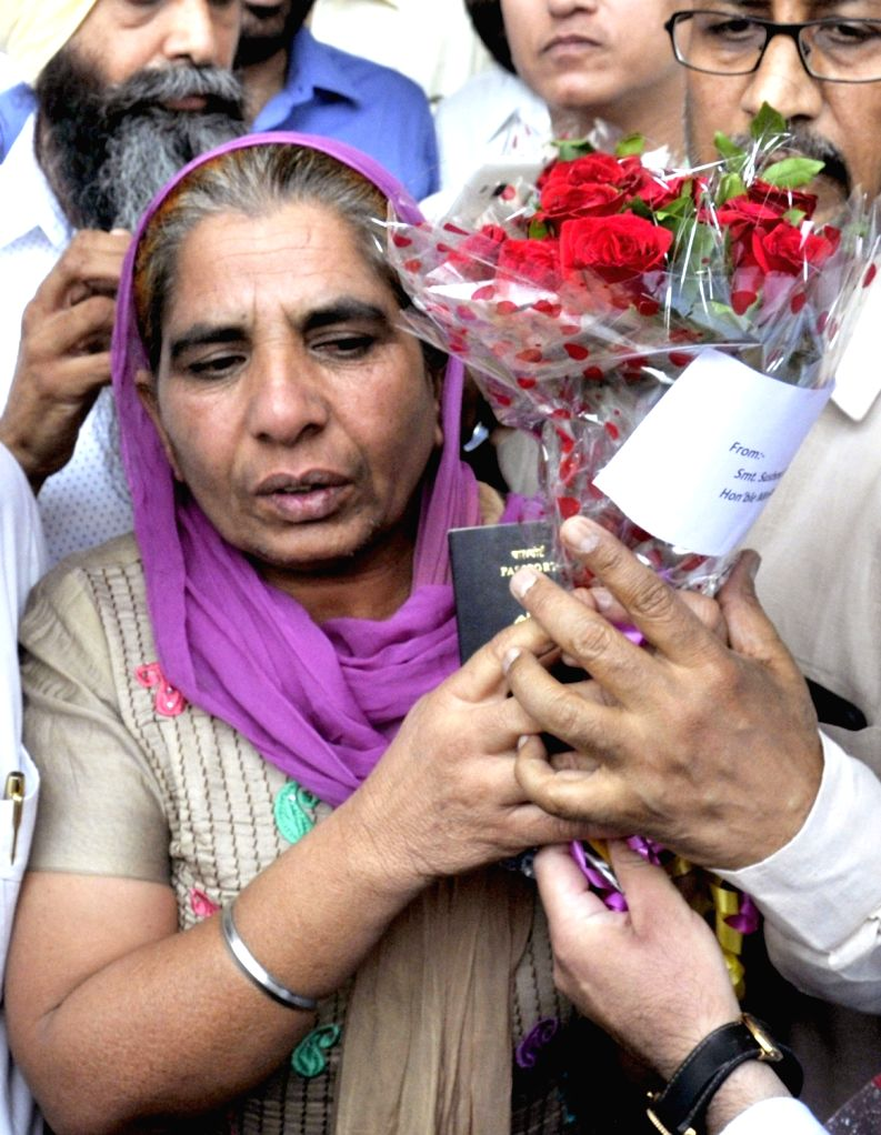 Sukhwant Kaur, who was allegedly sold by  travel agents and tortured in Saudi Arabia being received on her arrival in Amritsar on May 31, 2017. Her husband Kulwant Singh had External Affairs Minister ... - Sukhwant Kaur and Kulwant Singh
