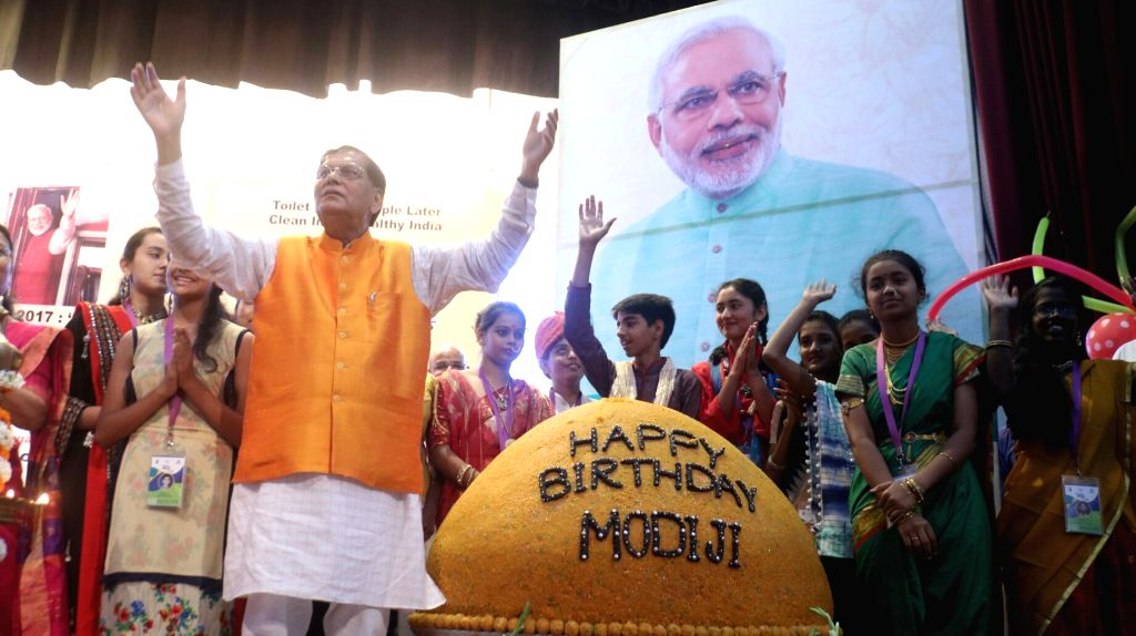 Sulabh International, an India-based social service organisation Founder Bindeshwar Pathak celebrates the birth day of Prime Minister Narendra Modi with a 267 kg jumbo laddu accompanied by ... - Narendra Modi and Bindeshwar Pathak
