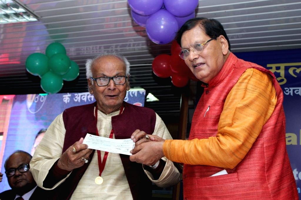 "Sulabh International founder Bindeshwar Pathak presents ""Sulabh Art Award "" to artist Phani Bhushan Biswas, on the 49th foundation day of Sulabh International, in New Delhi, on ... - Phani Bhushan Biswas and Bindeshwar Pathak"