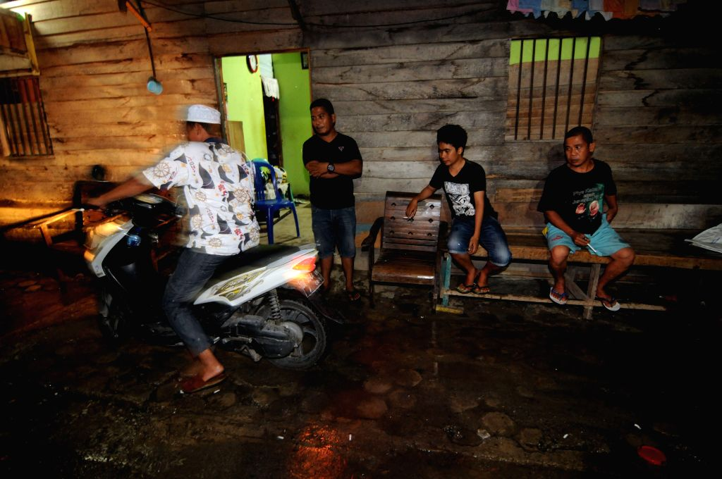 SULAWESI, May 30, 2017 - People stay outside their houses after a powerful under earth quake of 6.6 magnitude jolted Indonesia's Central Sulawesi, on May 29, 2017, according to the local meteorology ...