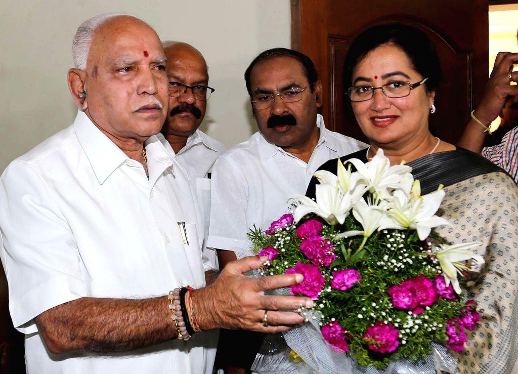 Sumalatha Ambareesh who is contesting as an independent candidate from Mandya in the 2019 Lok Sabha elections, meets Karnataka BJP President B. S. Yeddyurappa in Bengaluru, on March 25, ...