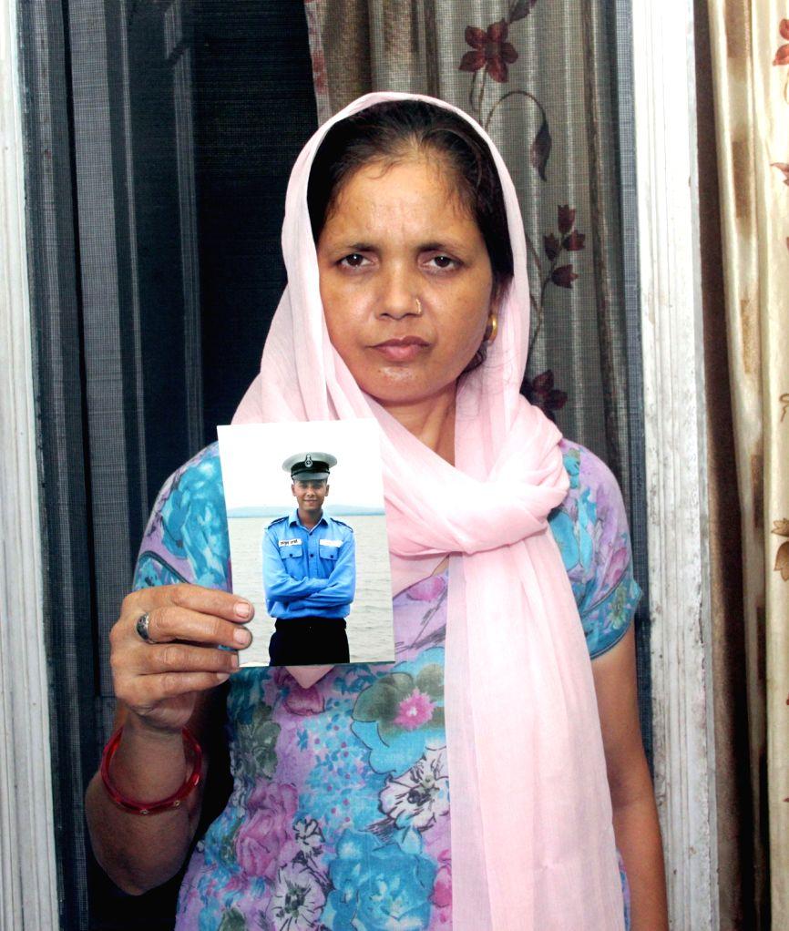 Suman Sharma, mother of Atul Sharma, a sailor from Amritsar who is feared dead in INS Sindhurakshak blast incident at Amritsar on August 17, 2013. (Photo::: IANS) - Suman Sharma
