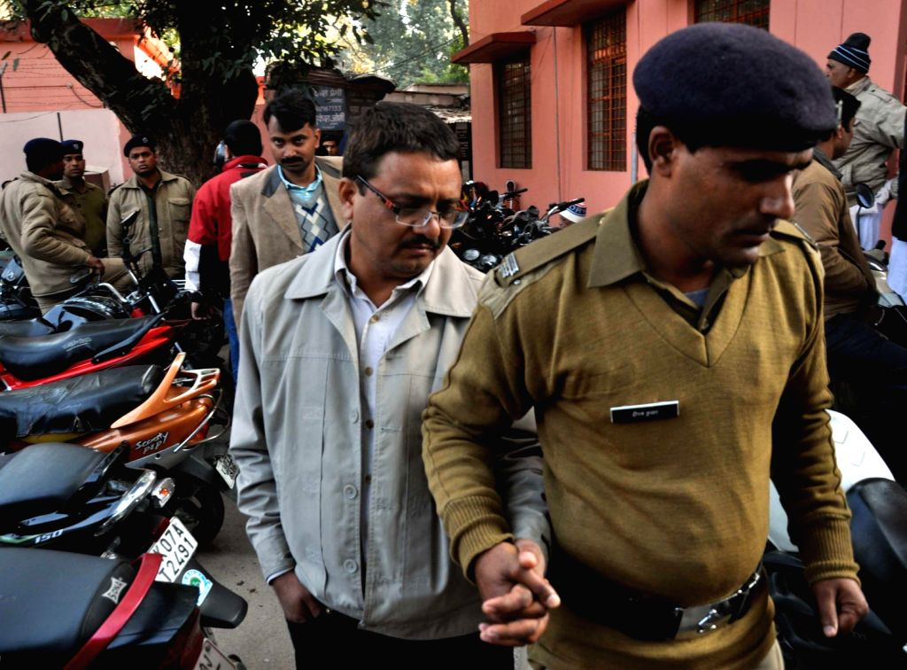 Suman Singh Waldia, Joint Secretary (Social Welfare), Uttarakhand  being produced in a court for his alleged involvement in a high profile sex scandal in Dehradun on Dec.20, 2013.