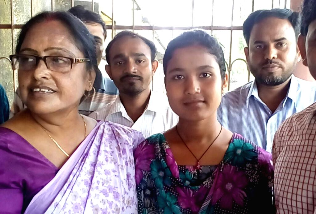 Sumana Khatun, the topper of West Bengal Board of Madrasah Education (WBBME) with her teachers at Basanti near Kumarganj in South Dinajpur district of West Bengal on May 13, 2016.