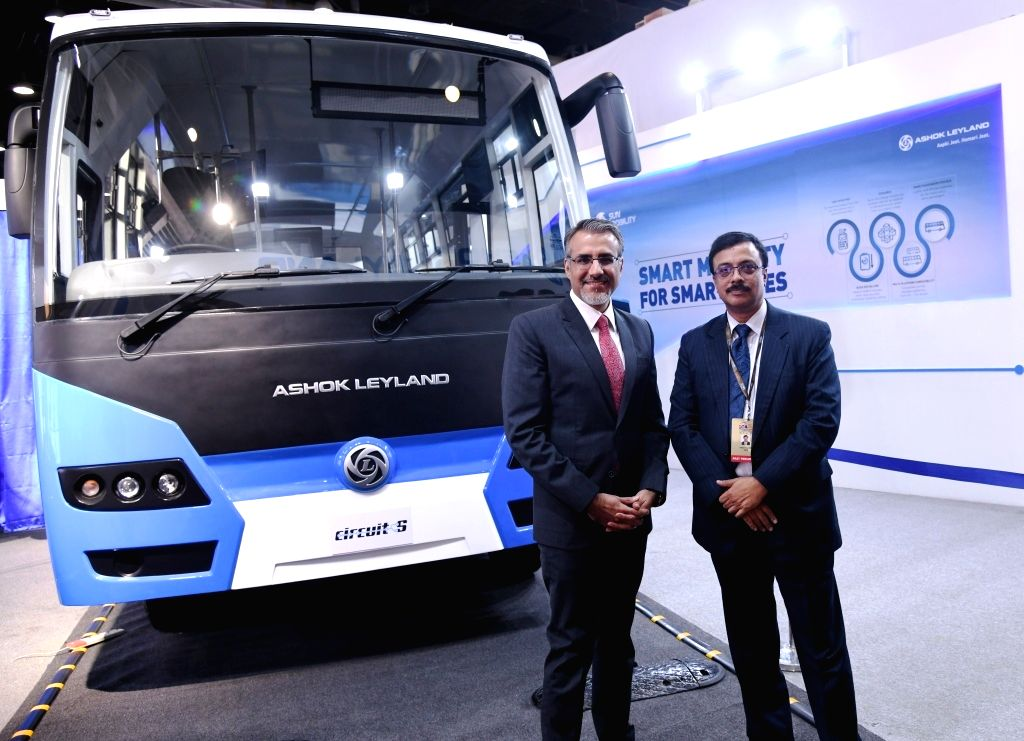 SUN Mobility Co-Founder and Vice Chairman Chetan Maini (L) and Ashok Leyland MD Vinod K. Dasari (R) unveil Ashok Leyland electric bus – Circuit-S at Auto Expo 2018 in New Delhi on Feb 8, ...