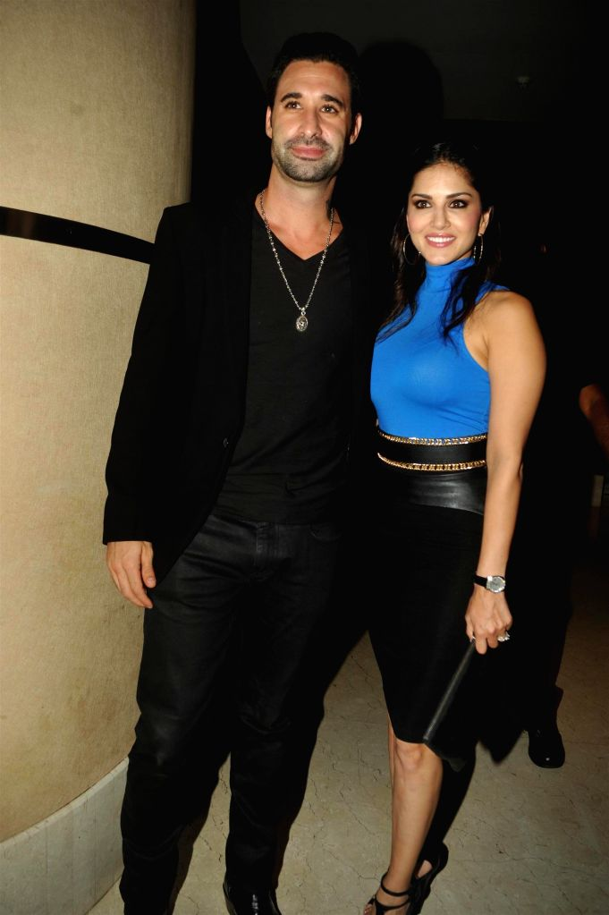 Sunny Leone with her husband Daniel Weber during the music launch of film Balwinder Singh Famous Ho Gaya in Mumbai, on Sept 9, 2014. - Sunny Leone