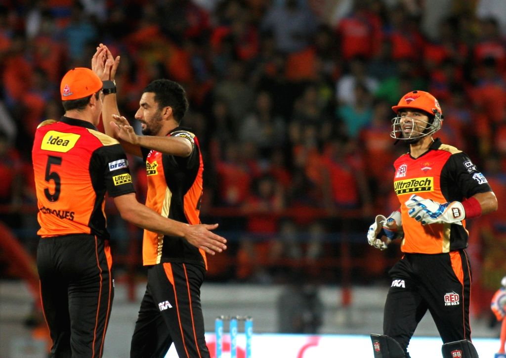 Sunrisers Hyderabad celebrate fall of a wicket during an IPL match between Gujarat Lions and Sunrisers Hyderabad at Saurashtra Cricket Association Stadium in Rajkot on April 21, 2016.
