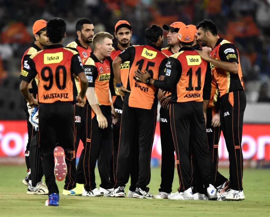 Sunrisers Hyderabad players celebrate fall of a wicket during an IPL match between Sunrisers Hyderabad and Mumbai Indians at Rajiv Gandhi International Stadium in Hyderabad, on April 18, ...