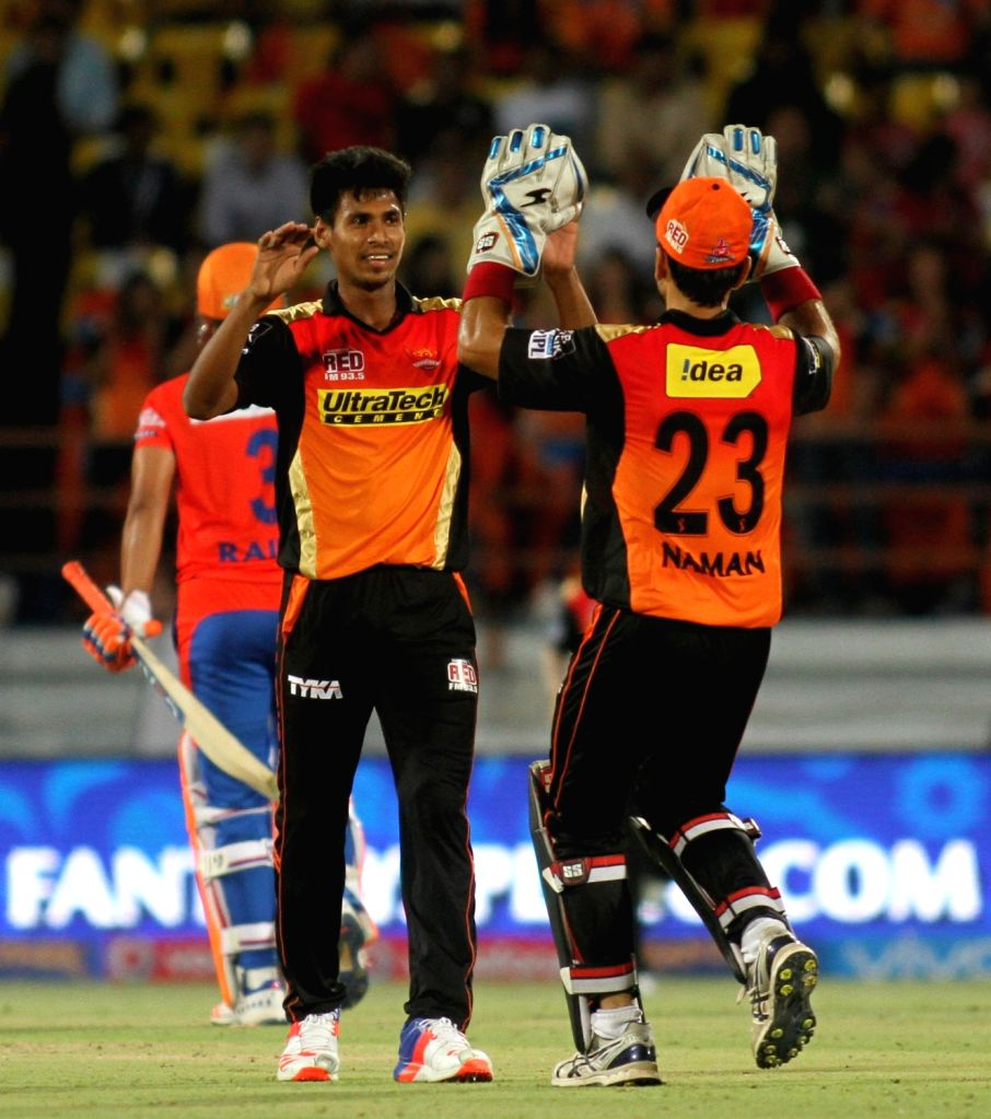 Sunrisers Hyderabad players celebrate fall of a wicket during an IPL match between Gujarat Lions and Sunrisers Hyderabad at Saurashtra Cricket Association Stadium in Rajkot on April 21, 2016.