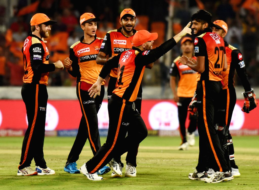 Sunrisers Hyderabad players celebrate fall of a wicket during the 48th match of IPL 2019 between Sunrisers Hyderabad and Kings XI Punjab at Rajiv Gandhi International Stadium in Hyderabad, ...