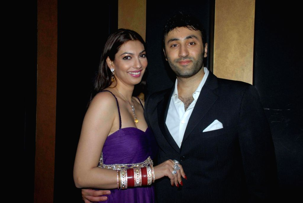 Supermodel-actress Yukta Mookhey with her husband at an event hosted by politician Asif Bhamla's organisation Love India. The team members of the Oscar award-winning international film were honou - Yukta Mookhey