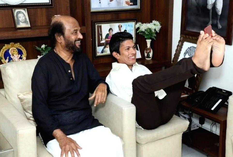 Superstar Rajinikanth recently met Kerala based differently-abled artist Pranav in Chennai. - Pranav