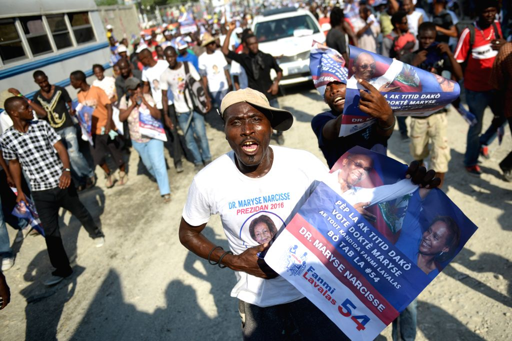 Supporters attend a campaign rally of Maryse Narcisse, presidential candidate of Fanmi Lavalas party, in Port-Au-Prince, Haiti, on Oct. 23, 2015. Haiti will ...