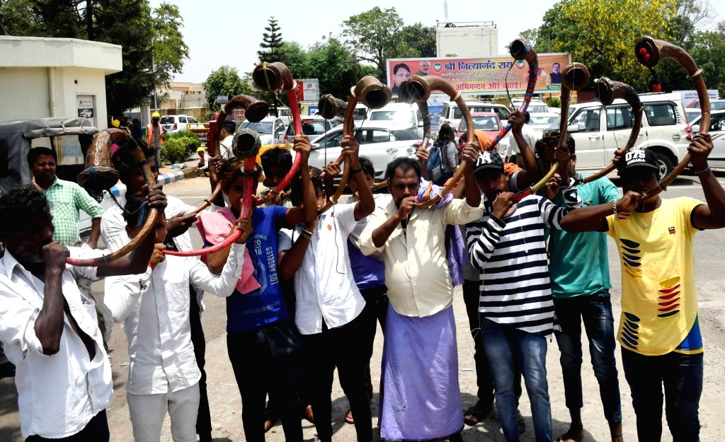 Supporters blow 'bigul' to welcome Union MoS Home Nityanand Rai ahead of his arrival, at Jay Prakash Narayan International Airport in Patna on June 15, 2019. - Nityanand Rai