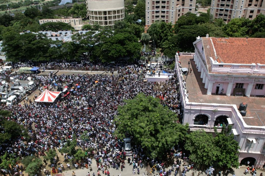 Supporters in large numbers gather near Rajaji Hall, where the 94-year-old DMK patriarch and former Tamil Nadu Chief Minister M. Karunanidhi's body lays in state for people to pay homage; in ... - M. Karunanidh