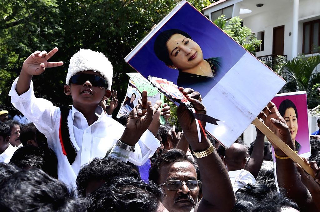 Supporters of AIADMK celebrates their party chief J Jayalalithaa`s victory in RK Nagar by-poll at Poes Garden in Chennai on June 30, 2015.
