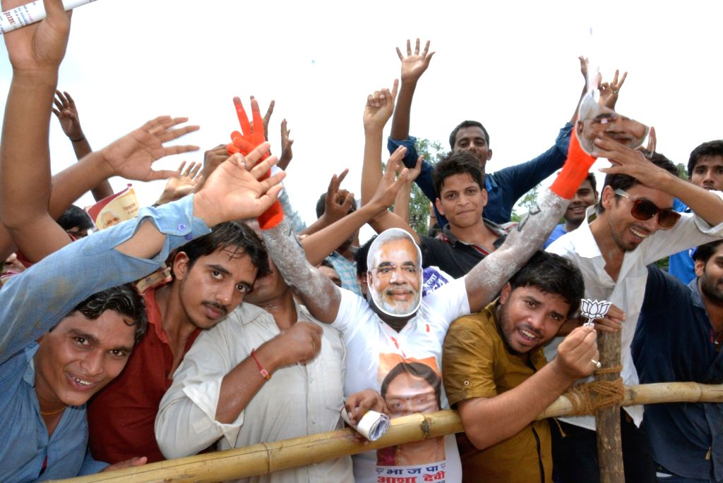 Supporters of BJP during the inauguration of skill training centres, in Ara, of Bihar on Aug 18, 2015.