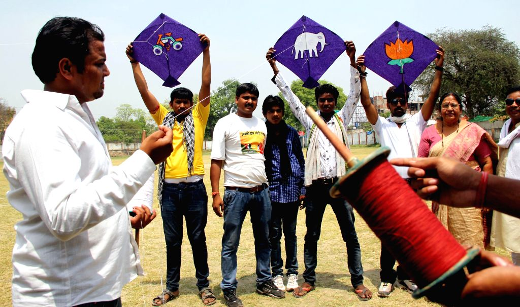 Supporters of different political parties during a kite flying competition in Allahabad on April 16, 2014.