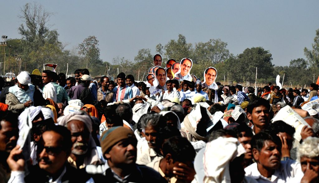 Supporters of Madhya Pradesh Chief Minister Shivraj Singh Chouhan Singh Chouhan during his swearing-in ceremony in Bhopal on Dec. 14, 2013. - Shivraj Singh Chouhan Singh Chouhan