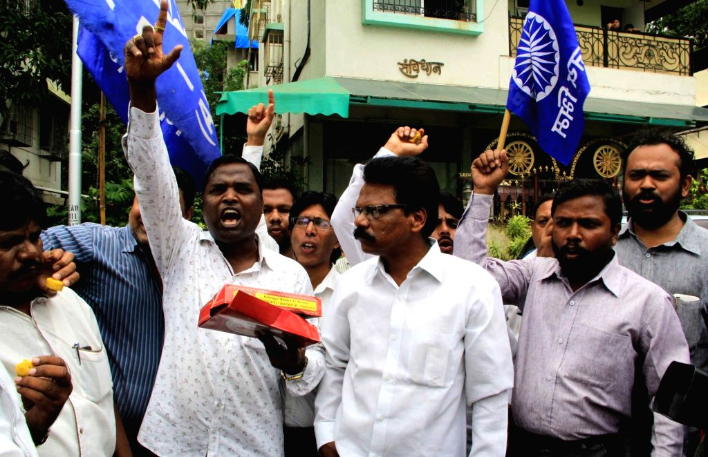 Supporters of RPI leader Ramdas Athawale celebrate after he was appointed Union Minister of State; in Mumbai on July 5, 2016.