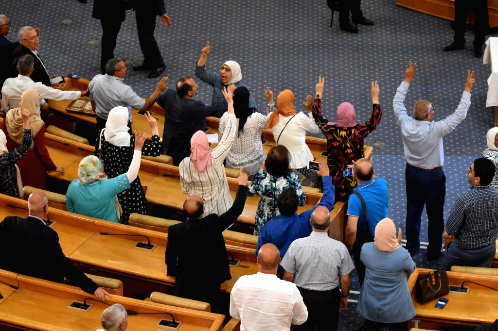 Supporters of Tunisian Parliament Speaker Rached Ghannouchi celebrate in the parliament in Tunis, Tunisia, on July 30, 2020. Tunisian Parliament Speaker Rached ... - Rached Ghannouchi
