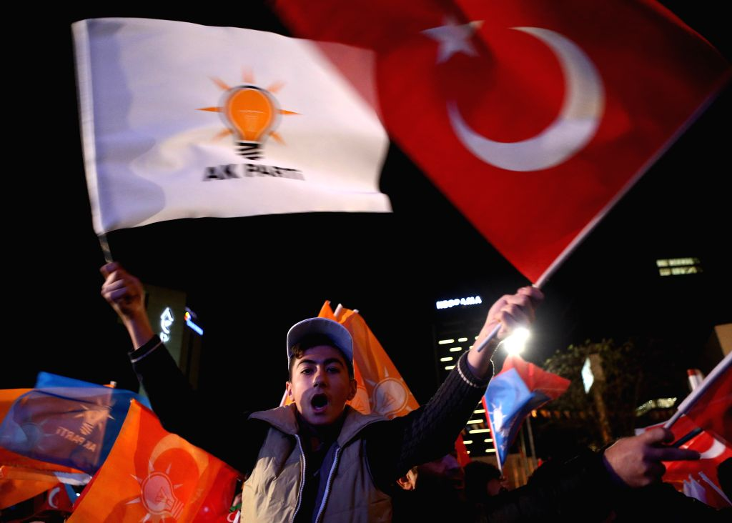 Supporters of Turkey's ruling Justice and Development Party (AKP) celebrate in front of the party's headquarters in Ankara, Turkey, Nov. 1, 2015. Turkey's ruling AKP ...