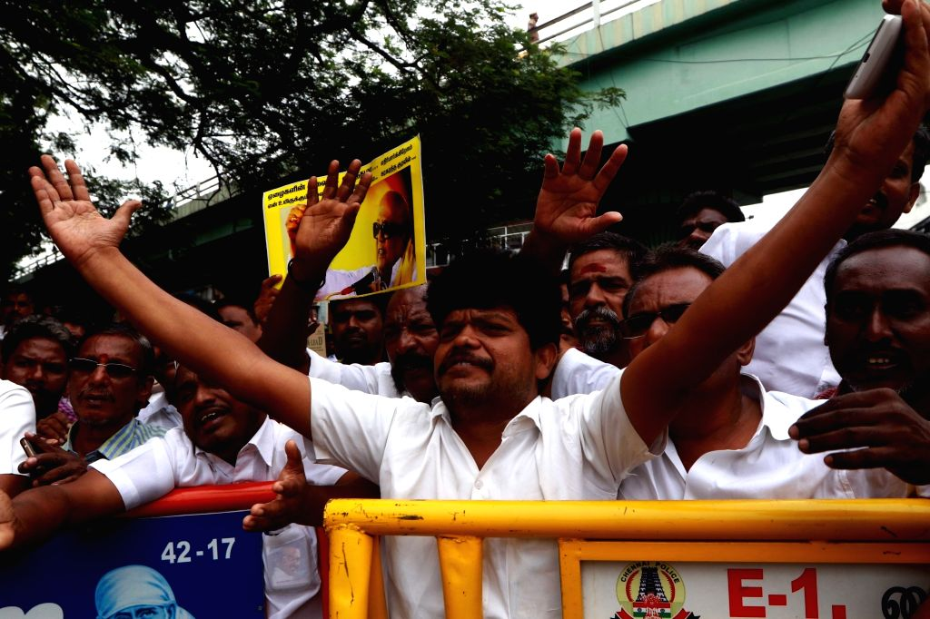 Supporters wait for updates on the health of DMK President M. Karunanidhi outside the Kauvery Hospital where he is admitted, in Chennai, on Aug 7, 2018.