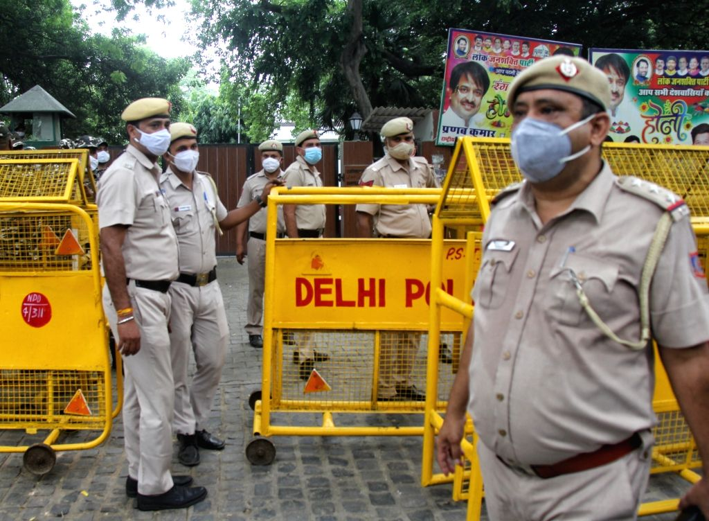 Supports of LJP's Chirag Paswan protest against Pashupati Kumar Paras residence also seen in police barricades in front of Chirag Paswan residence in New Delhi on Wednesday June 16, 2021. - Pashupati Kumar Paras