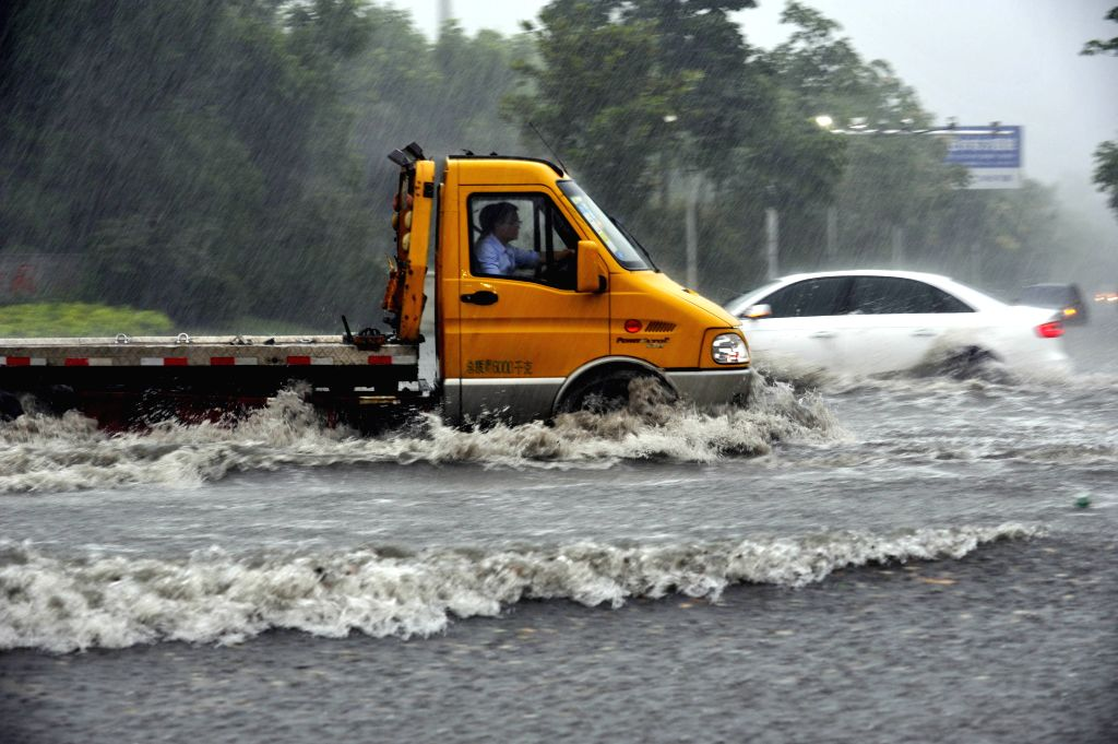 SUQIAN, June 23, 2016 - Vehicles run in the rain in Suqian, east China's Jiangsu Province, June 23, 2016. China's central meteorological authority issued a yellow warning for heavy rain in east, ...