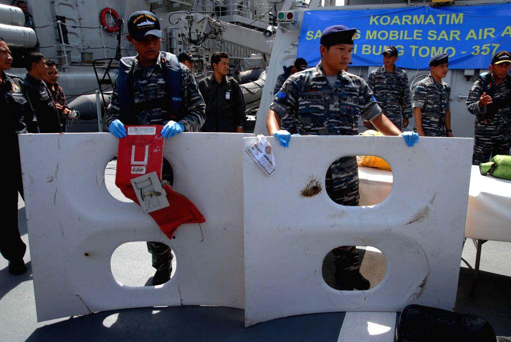 SURABAYA, Jan. 5. 2015 Indonesian Navy crew members of ship KRI Bung Tomo show the media the debris of AirAsia flight QZ8501 recovered in search operations at a naval base in Surabaya, ...