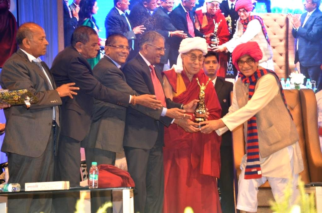 Gujarat Governor O P Kohli confers 7th Santokbaa award to Dalai Lama the spiritual head of Tibetan Buddhists during a programme organised by SRK Foundation in Surat, on Jan 2, 2015. - O P Kohli