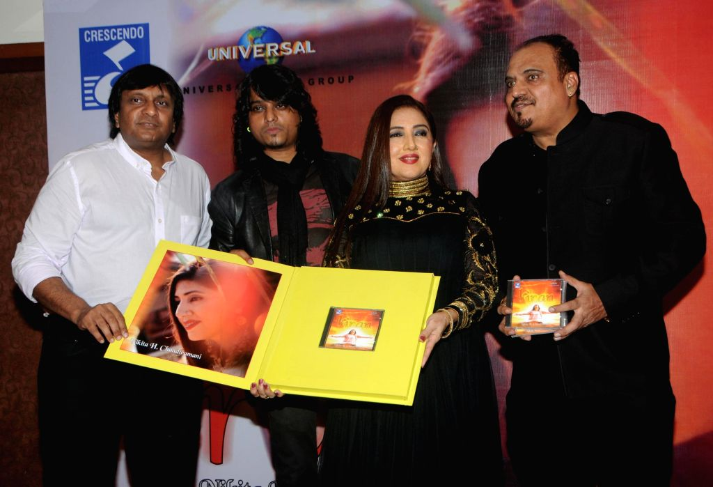Suresh Thomas (Cresendo-Universal Music) with singer Nikita H Chandiramani, Aziz Zee and Mr. Chandiramani during the music release of album Kiran, in Mumbai, on Aug 18, 2014.