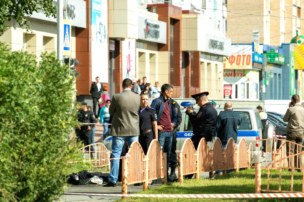 SURGUT, Aug. 19, 2017 - Police work on the site of a knife attack in the center of Surgut, Russia, on Aug. 19, 2017. The Islamic State (IS) terrorist group has claimed responsibility for a knife ...