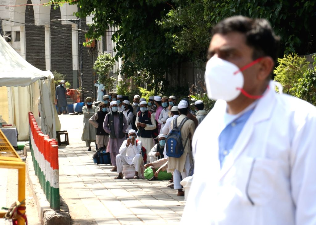 Suspected coronavirus patients being taken to Lok Nayak Jai Prakash Narayan Hospital from Delhi's Nizamuddin area where a religious congregation of 2000 people at a mosque has thrown up ...