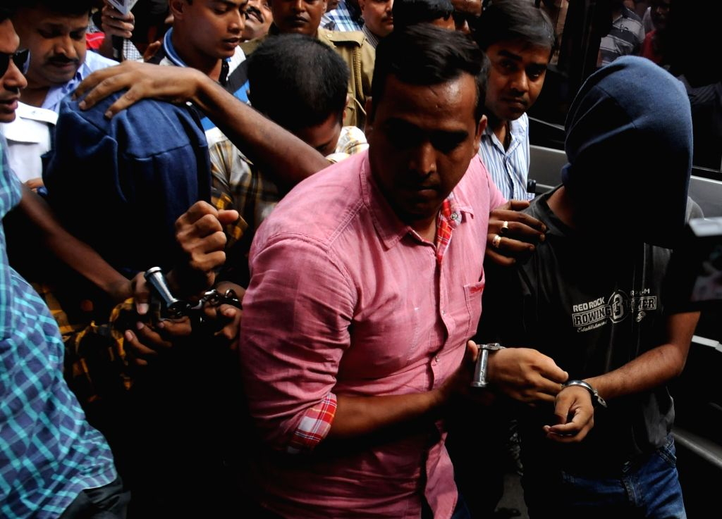 Suspected Jamaat-ul-Mujahideen Bangladesh (JMB) activists who were arrested from Assam and West Bengal being taken to be produced at a Kolkata court on Sept 26, 2016. According to police out ...