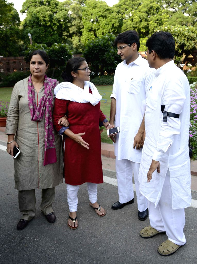 Suspended Congress MPs at the Parliament in New Delhi, on Aug 3, 2015.