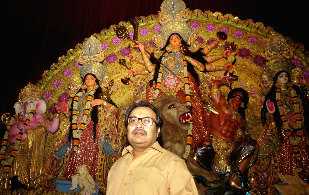 Suspended Trinamool Congress MP Kunal Ghosh, an accused in the multi-crore-rupee Saradha chit fund scam visits a Durga Puja pandal after getting bail in Kolkata on Oct 7, 2016. He was ... - Kunal Ghosh